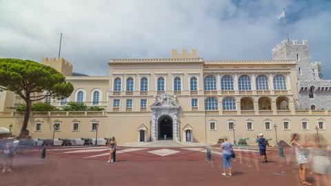 Facade of Prince's Palace of Monaco timelapse hyperlapse and square in front of it. It is the official residence of the Prince of Monaco. Built in 1191. Cloudy sky at summer day. People walking around