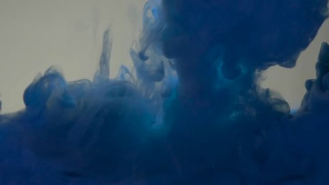 Blue color paint pouring in water. Acrylic colors and ink in water. Abstract frame background. Colors and ink in water