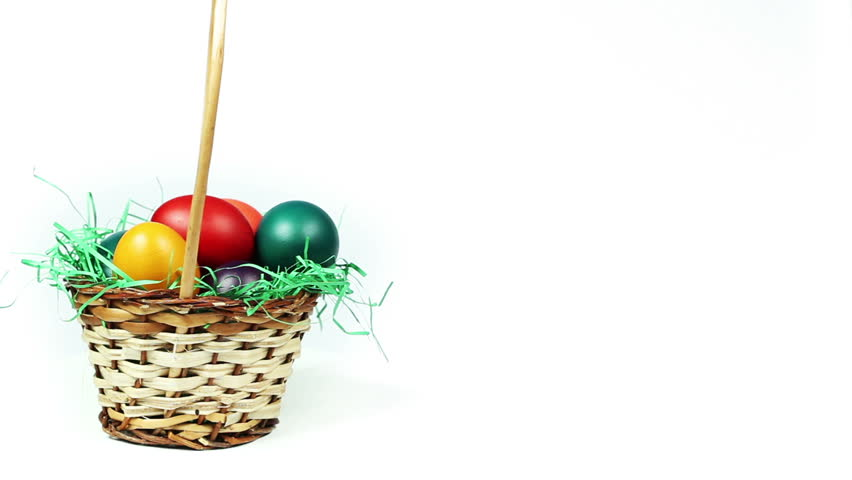Basket of Easter Eggs - Colorful Easter eggs in a basket with green grass decoration, white background, seamless loop