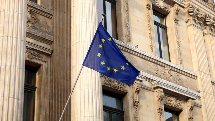 Stock Exchange Building (La Bourse de Bruxelles) in Brussels, European Flag, EURO