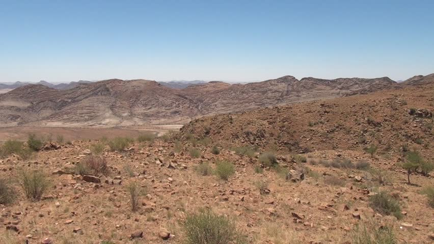 HD scenic video of desert and mountains from top of Spreetshoogte Pass towards sand sea area of Sossusvlei Namib Desert red sand dunes on sunny day in Namib-Naulkuft Park in Namibia, southern Africa