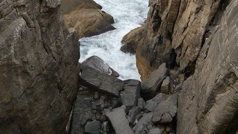 View from above rocks on the coast at Cabo Carvoeiro in Portugal