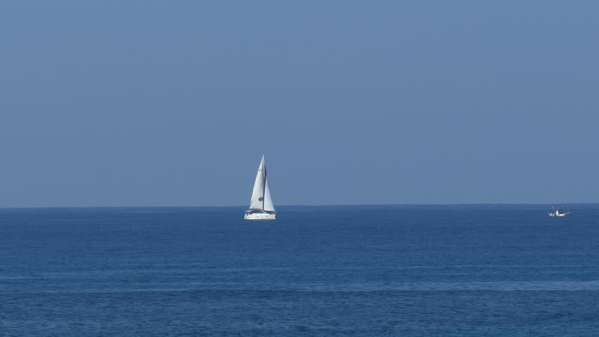 Zoom out from white yacht on Mediterranean Sea at winter