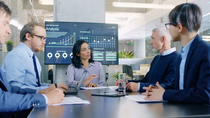 Diverse Group of Successful Business People in the Conference Room Discuss Company's Matters. They Work on a Company's Growth, Share Charts and Statistics. Shot on RED EPIC-W 8K Helium Cinema Camera.