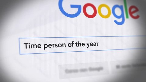 USA-Popular searches in 2017 Google Search Engine - Search For Time person of the year Monitor with reflection hands typing a search on google