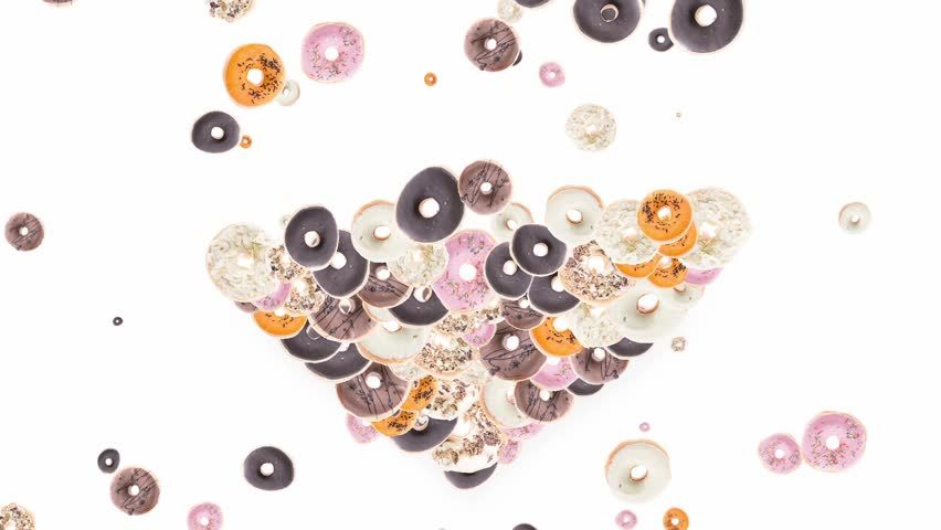 Donuts falling down and shaping a heart on white background
