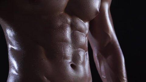 Bodybuilder, sixpack, black background