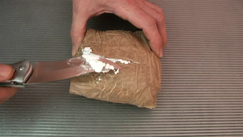Police Checking Brick Of Cocaine Found