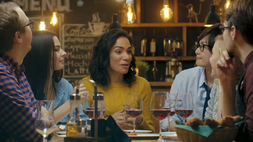 In the Bar/ Restaurant Beautiful Hispanic Woman Shares Good News with Her Dear Friends They Congratulate Her Heartily and Applaud. They Sit in the Stylish Hipster Establishment.  #34161205