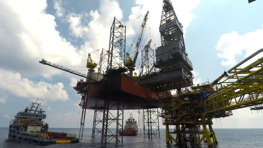 KELANTAN, MALAYSIA - DECEMBER 21ST 2017 : Time lapse at offshore field with UMW Naga 8 jack up drilling rig, supply vessels and Bergading well head platform Alpha at North Malay Basin field.