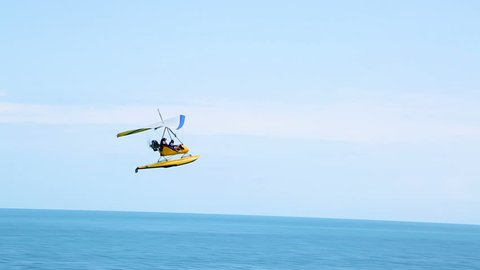 Deltaplane circling over the sea, extreme sports, Batumi tourist attractions