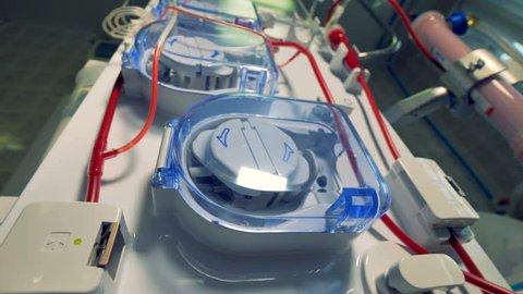 Modern dialysis machines making blood purification. Patient during hemodialysis procedure.