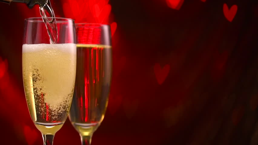 Pouring Champagne in two glasses over holiday blinking red background with hearts. Valentine's Day, Wedding celebrating. Couple of flute with champagne close up. Slow motion 4K UHD video | Shutterstock HD Video #34294945