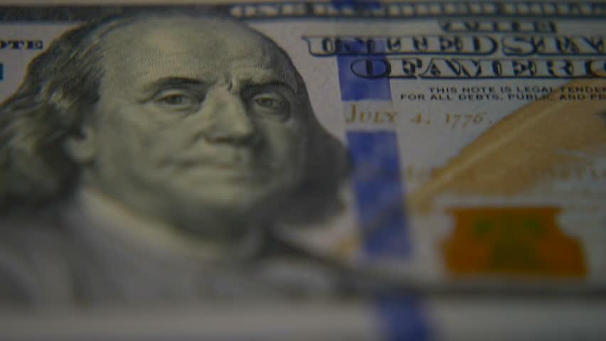 Dollar bills close-up. Macro photography of bank notes. Portrait of George Washington.   Shutterstock HD Video #34343755