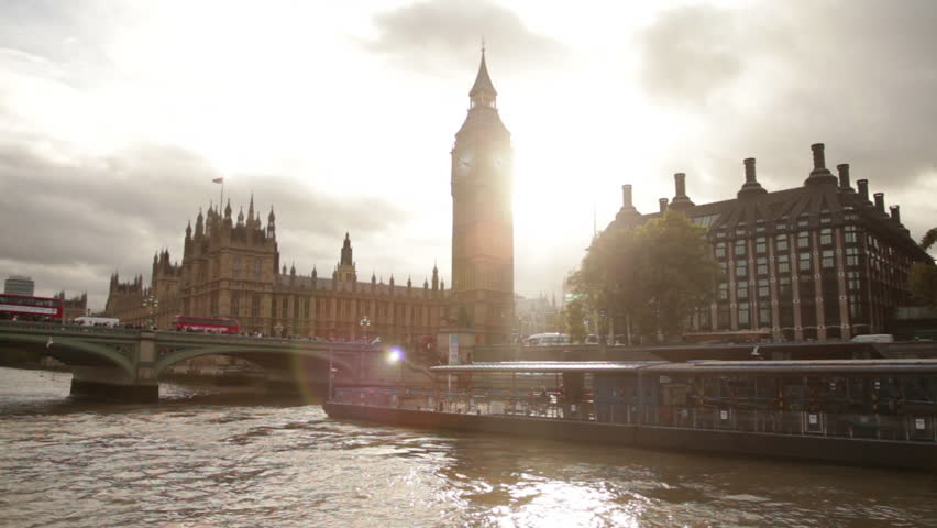 Sun Glare behind Big Ben and Westminster palace in London, England.