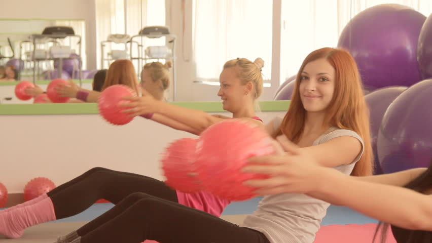 Beautiful sexy girls working out in modern gym club as part healthy lifestyle. | Shutterstock HD Video #3438716