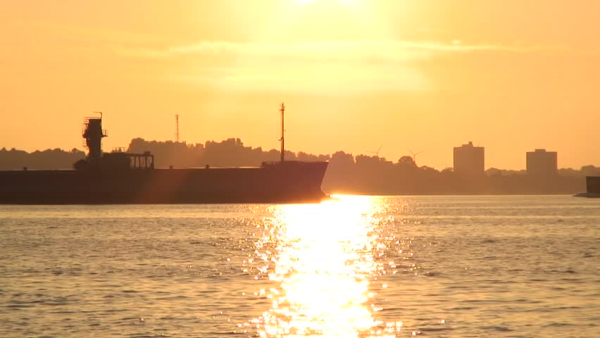 Cargo ships in the sunset