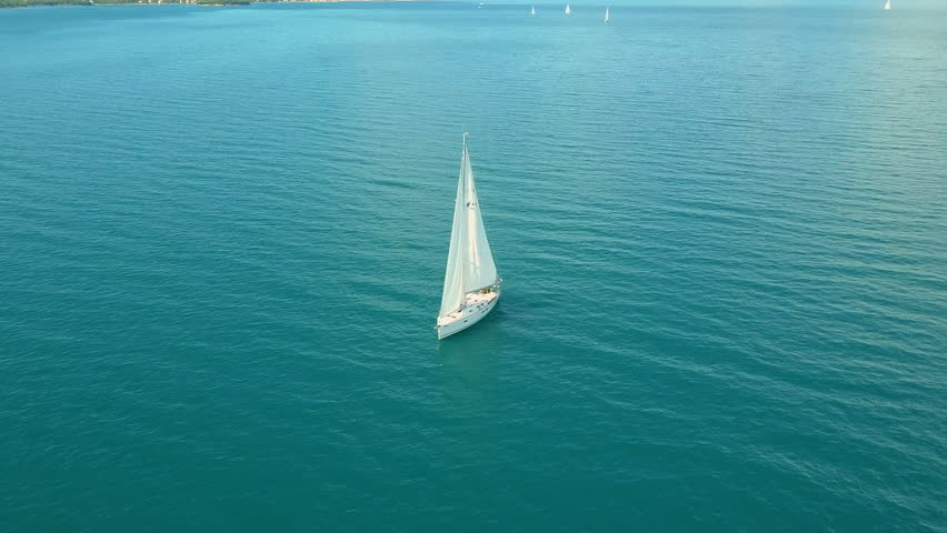 Yacht sailing on opened sea. Sailing boat. Yacht from drone. Yachting video. Yacht from above. Sailboat from drone. Sailing video. Yachting at windy day. Yacht. Sailboat. | Shutterstock HD Video #34396435