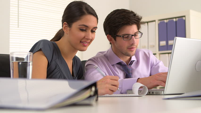 Business colleagues taking notes | Shutterstock HD Video #3441095