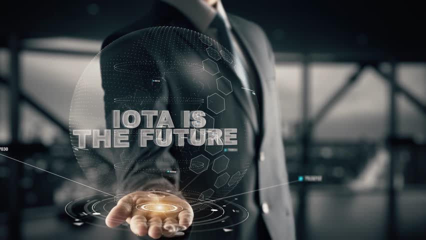 Businessman with IOTA is the Future hologram concept