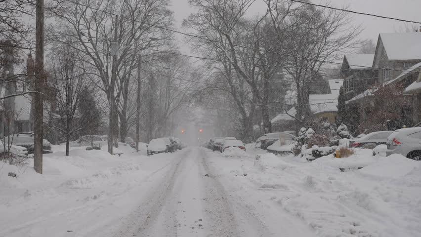 Heavy snow falling on suburban street. Winter in East York, Toronto, Canada.  | Shutterstock HD Video #34442335