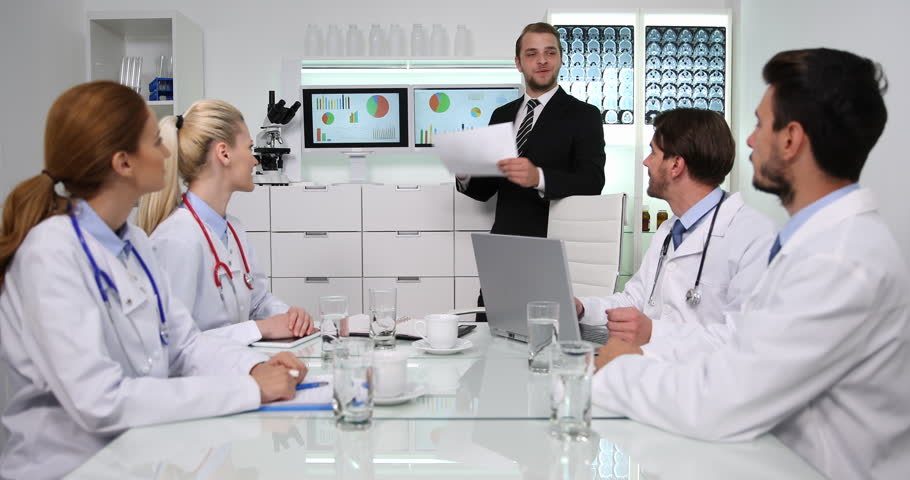 Manager Man Positive Dialogue to Medical Doctors Team About Pie Chart Data News   Shutterstock HD Video #34567645