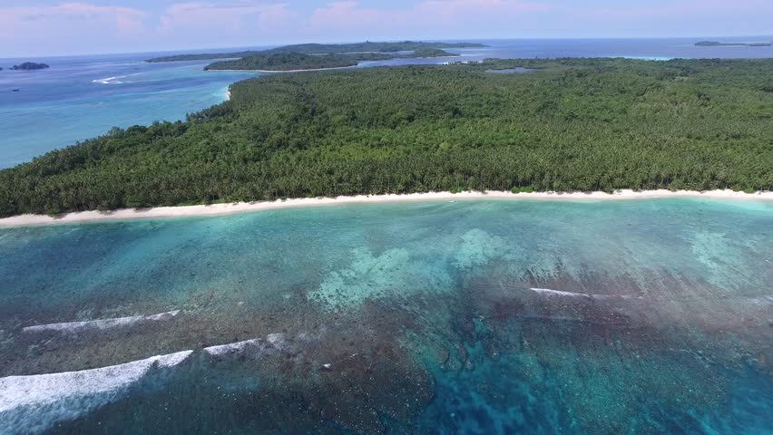 The Mentawai Islands are a chain of about seventy islands and islets approximately 150 kilometres (93 miles) off the western coast of Sumatra in Indonesia.