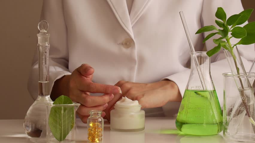 the scientist,dermatologist testing the organic natural cosmetic product in the laboratory.research and development beauty skincare  .cream,serum.
