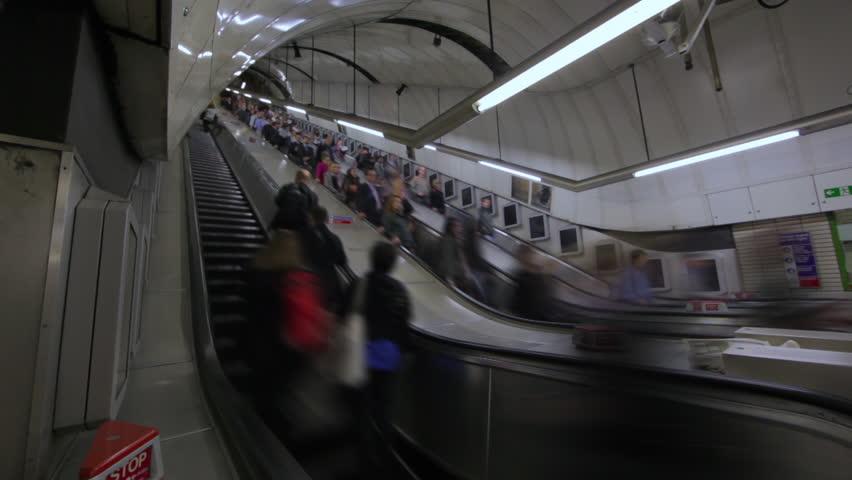LONDON - OCTOBER 6, 2011: Time lapse of Escalators at Soho Station, London   Shutterstock HD Video #3463955