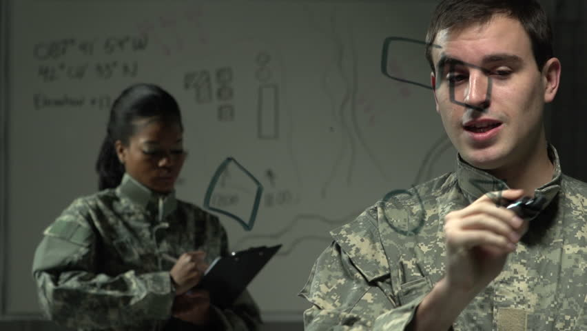 Soldier explaining a plan of action to a fellow soldier