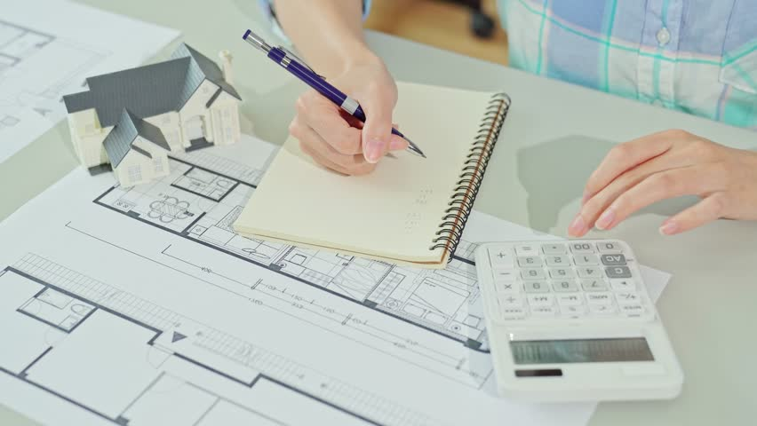 Price tag blueprint stop motion style animation stock footage top above view of architect architecture drawing project blueprint office and using calculator to count the malvernweather Gallery