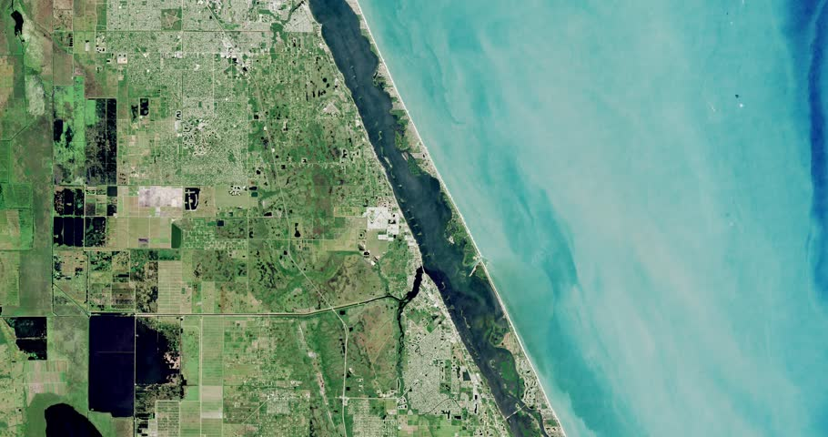 Very high-altitude overflight aerial of coastal land and water, Brevard County Florida. Clip loops and is reversible. Elements of this image furnished by NASA
