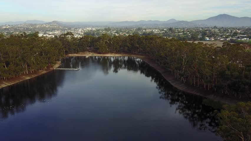 San Diego - Chollas Lake - Drone Video  Aerial Video of Chollas Lake is a tiny lake in San Diego that offers fishing for Kids. Great place to get some exercise, there is a loop around the lake.