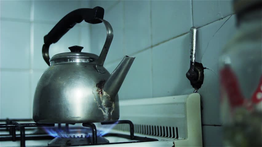 Vintage Kettle boiling on a Gas Stove.