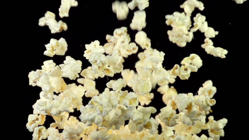 Bucket of popcorn exploding into the air. Shot with high-speed camera.