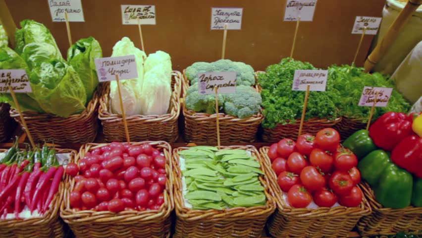 Different vegetables lay in baskets at market place