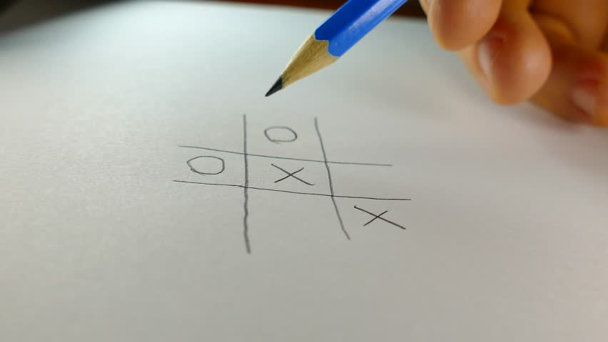 Tic-tac-toe playing on paper with a pencil.