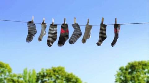 Laundry Line with Baby Socks in the Wind (HD)