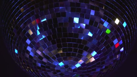 Disco ball rotates. Close-up. A party. Performance. reflection of light. Lighting device.