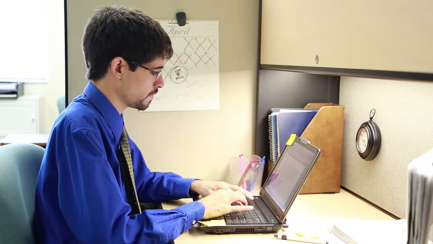 man working in cubicle