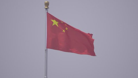 Center framed view of a flag in Tiananmen Square in China