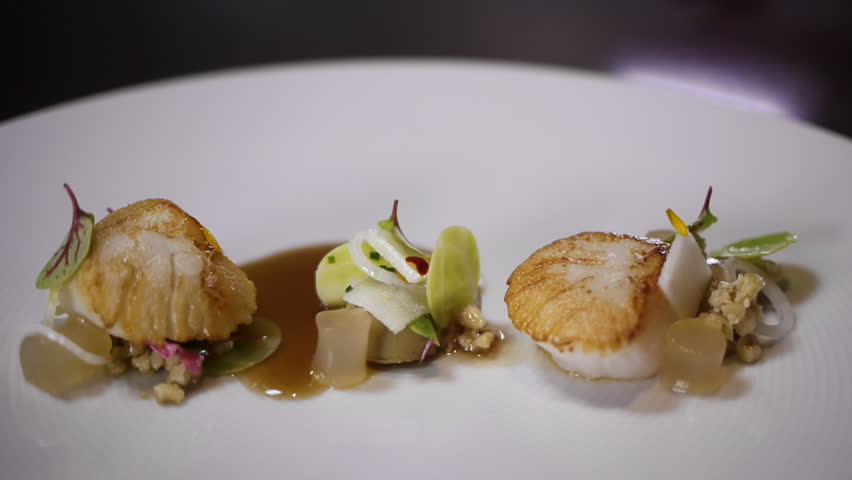 Gourmet restaurant food scallop saucing