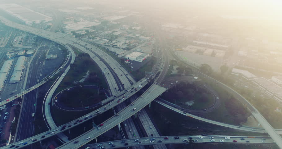 Above busy freeway intersection at sunset during rush hour traffic - aerial shot | Shutterstock HD Video #34855345