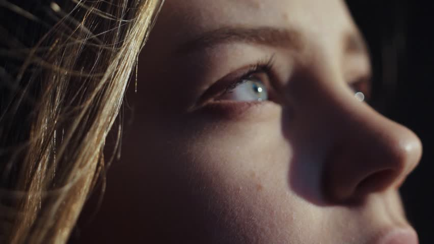 close up shot face young sensual european girl open blue eyes look brihgt morning sun light deep breathes in new life calm wind atmosphere