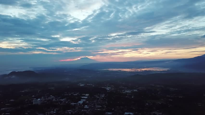 Beautiful aerial village view with mountain background from a drone flying from left to right in Semarang, Indonesia. Shot in 4k resolution | Shutterstock HD Video #34878385