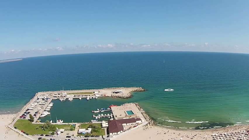 Marina and the main beach in Eforie Nord , an attractive travel destination for summer vacations on the Black Sea coast , Romania, Eastern Europe , aerial view