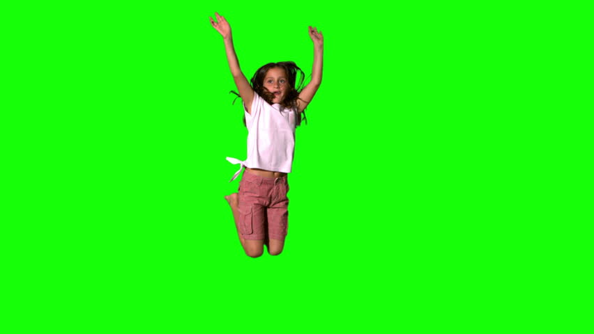 Happy girl jumping up on green screen in slow motion #3497525