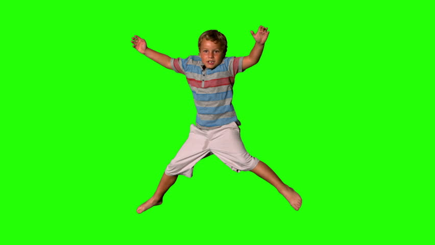 Boy jumping on a green screen in slow motion