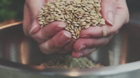 cinematic effect of lentils dropped in bowl