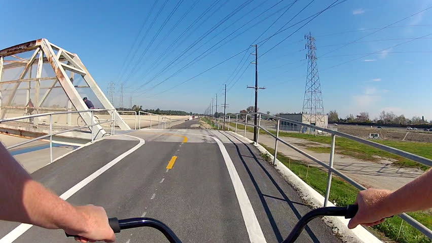 LONG BEACH, CA - February 23, 2013: The POV of someone riding a bicycle across a